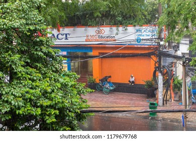 Ho Chi Minh City, Vietnam - Sep 11, 2018: an undefined man is sheltering from the rain with his cyclo