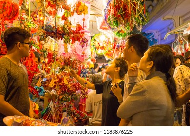 Ho Chi Minh City, Vietnam - September 19, 2018: People come to the street of lanterns to shop and take photos for the mid-autumn festival.