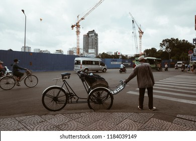 Ho Chi Minh City, Vietnam - Aug, 2018: Cyclos on street waiting guests. Royalty high-quality free stock image of cyclo bicycle. Cyclos is the preferred means of transportation for tourist