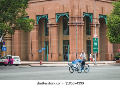 Ho Chi Minh City, Vietnam - October 5, 2018: Unidentified man riding a traditional cyclo in Saigon Notre-Dame Cathedral Basilica, Vietnam.