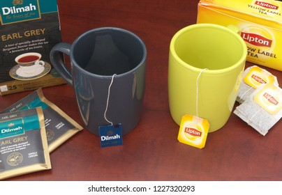HO CHI MINH CITY, VIETNAM - NOVEMBER 11, 2018: Lipton and Dilmah tea bags in cups and boxes of tea on wooden table. Lipton and Dilmah are  famous brands in tea industry.