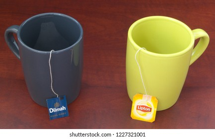 HO CHI MINH CITY, VIETNAM - NOVEMBER 11, 2018: Lipton and Dilmah tea bags in cups on wooden table. Lipton and Dilmah are  famous brands in tea industry.