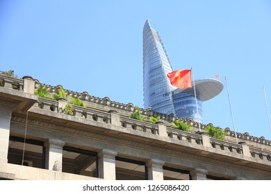 Ho Chi Minh City, Vietnam - February 21, 2018: Historical Building with Bitexco Financial Tower in the Background  Ho Chi Minh City retains a lot of colonial buildings but also has a modern skyline