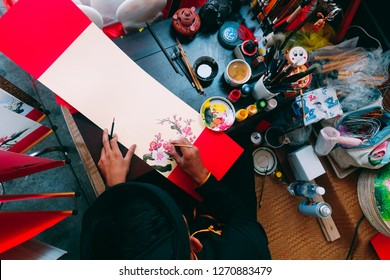 Ho Chi Minh city, Vietnam 01-2018: Vietnamese scholar writes calligraphy at lunar new year. Calligraphy festival is a popular tradition during Tet holiday. Culture of Vietnamese Tet in springtime