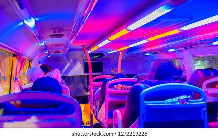Ho Chi Minh City, Vietnam - December 2018. Interior of overnight sleeper bus of Futa Bus Lines (Phuong Trang). Interior illuminated with colorful LED lights. Long distance journey from Saigon to Hanoi