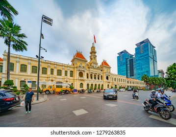 Ho Chi Minh City, Vietnam - December 25, 2018: Saigon City Hall, Vincom Center towers, colorful street traffic & tropical plants against the amazing blue sky. Saigon downtown with its famous landmark