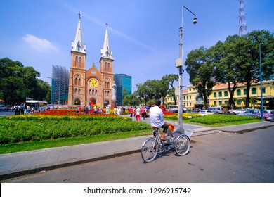 Ho Chi Minh City, Vietnam - Aug, 2018: Cyclos and driver on street waiting guests. Royalty high-quality free stock image of cyclo bicycle. Cyclos is the preferred means of transportation for tourist