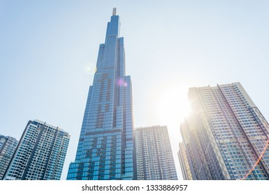 Ho Chi Minh City, Vietnam - February 19, 2019: Landmark 81 against the blue sky with sun shining and lens flares. This is the tallest skyscraper in Vietnam (opened in 2018) and all Southeast Asia.