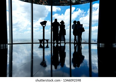 Ho chi minh city, Vietnam - March 21,2019: Tourist enjoy view of the Ho Chi Minh skyline from Bitexco Tower Skydeck with observatory in a cloudy day. Bitexco is building skyscraper