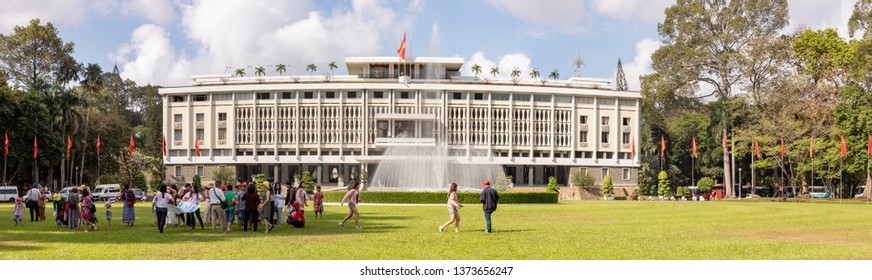 Ho Chi Minh City, Vietnam - March 9, 2019 :  Group of tourists on lawn in front of Reunification, or Independence, Palace in Ho Chi Minh City, or Saigon, Vietnam.