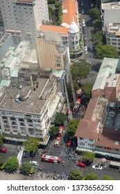 Ho Chi Minh City, Vietnam - March 9, 2019 :  Aerial view of firefighters working on high rise building fire in downtown Ho Chi Minh City, Vietnam.