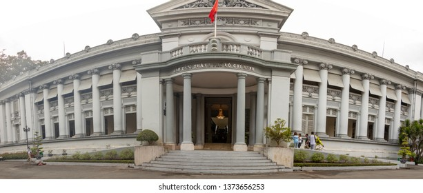 Ho Chi Minh City, Vietnam - March 11, 2019 :  Tourists at entrance to Ho Chi Minh Museum in Ho Chi Minh City, or Saigon, Vietnam.
