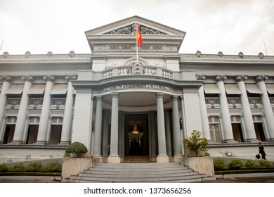 Ho Chi Minh City, Vietnam - March 11, 2019 :  Tourist at entrance to Ho Chi Minh Museum in Ho Chi Minh City, or Saigon, Vietnam.