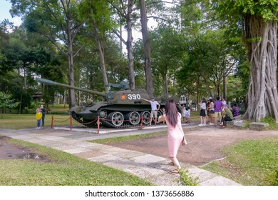Ho Chi Minh City, Vietnam - March 9, 2019 :   Vietnamese tourists posing with replica of North Vietnamese Tank at Reunification, or Independence, Palace in Ho Chi Minh City, or Saigon, Vietnam.