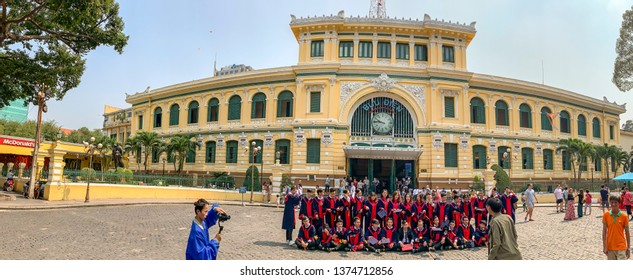 Ho Chi Minh City, Vietnam - March 16, 2019 :  Tourist and graduating class at entrance toGeneral Post Office in Ho Chi Minh City, or Saigon, Vietnam.