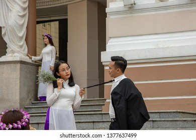 Ho Chi Minh City, Vietnam - March 15, 2019 :  Graduating class of university students posing for portraits on front steps of Opera House in Ho Chi  Minh City, or Saigon, Vietnam.