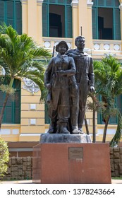 Ho Chi Minh City, Vietnam - March 15, 2019 : Statue of Viet Cong revolutionary soldiers outside General Post Office in Ho Chi  Minh City, or Saigon, Vietnam.