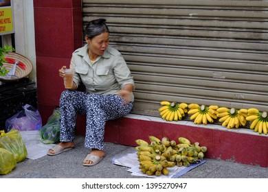 HO CHI MINH CITY, VIETNAM - SEPTEMBER 28, 2014: Vietnamese woman vendors in the street market of Ho Chi Minh City.