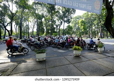 HO CHI MINH CITY, VIETNAM - SEPTEMBER 28, 2014: Motorbikes on the streets of Ho Chi Minh City in the morning. People wearing helmets for safety.