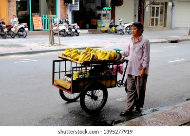 HO CHI MINH CITY, VIETNAM - SEPTEMBER 28, 2014: Vietnamese man vendors bananas in the street of Ho Chi Minh City.