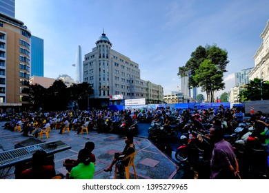 HO CHI MINH CITY, VIETNAM - SEPTEMBER 28, 2014: Vietnamese men and women gather to listen to open air live performance in Ho Chi Minh City.