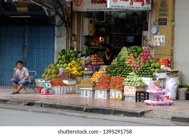 HO CHI MINH CITY, VIETNAM - SEPTEMBER 28, 2014: A Vietnamese man fresh fruit and vegetable seller sitting my his shop in Ho Chi Minh City.