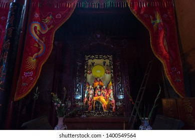 Ho Chi Minh City, Vietnam - April 27, 2019: an altar in the twilight of Tam Son (Tam Son Hoi Quan) Pagoda. The old temple located in Cho Lon, Saigon's Chinatown.