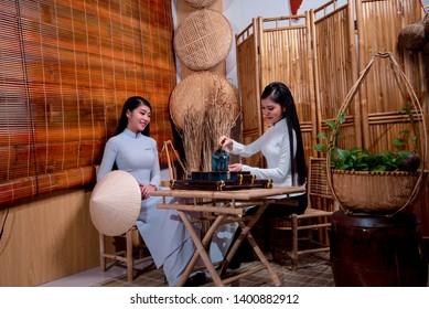 Ho Chi Minh City, Vietnam - 4 Feb 2019: Vietnamese girls wearing white Ao dai. Ao dai is famous traditional Custume for women in Vietnam.