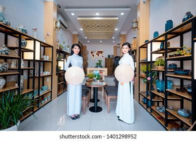 Ho Chi Minh City, Vietnam - 4 Feb 2019: Vietnamese girls wearing white Ao dai. Ao dai is famous traditional Custume for women in Vietnam