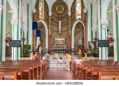 Ho Chi Minh City, Vietnam - April 15, 2019: the interior of St. Francis Xavier Parish Church with children playing around. This is Cho Lon known as Saigon's Chinatown, a popular travel destination.