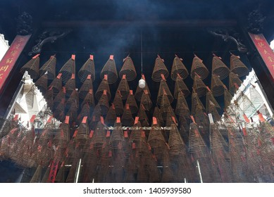 Ho Chi Minh City, Vietnam - April 27, 2019: spiral incense sticks hang from the ceiling in Thien Hau Pagoda. Thien Hau Pagoda is one of the highlights of Cho Lon, Saigon Chinatown.