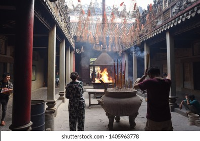 Ho Chi Minh City, Vietnam - April 27, 2019: visitors and worshipers in front of ritual fire in Thien Hau Pagoda. The pagoda is one of the highlights of Cho Lon, Saigon Chinatown.