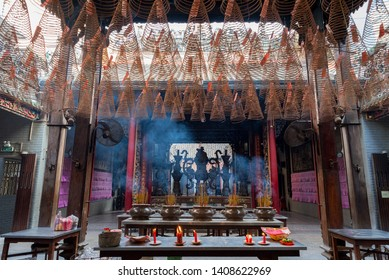 Ho Chi Minh City, Vietnam - April 26, 2019: an interior of Thien Hau Pagoda with hanging spiral incense sticks. Thien Hau Pagoda is one of the highlights of Cho Lon, Saigon Chinatown.
