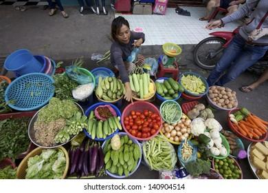 HO CHI MINH CITY, VIETNAM- CIRCA JUNE 2010: Street Vendor in Ho Chi Minh City, Vietnam selling vegetables on the sidewalk (Ho Chi Minh City, Vietnam - CIRCA June, 2010)