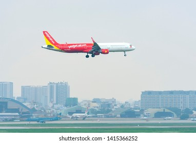 Ho Chi Minh City, Vietnam - May 29th, 2019: Vietjet Air airbus a321 landing at Tan Son Nhat International Airport in Ho Chi Minh City, Vietnam. Vietjet Air is the first low cost airline in Vietnam