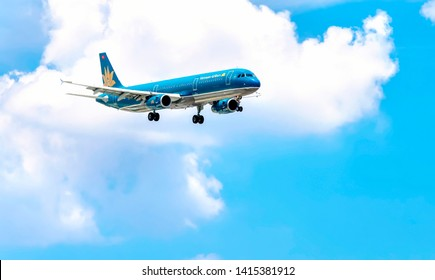 Ho Chi Minh City, Vietnam - June 1st, 2019: Vietnam airlines flying through the clouds sky to prepare landing at Tan Son Nhat International Airport in Ho Chi Minh City, Vietnam.