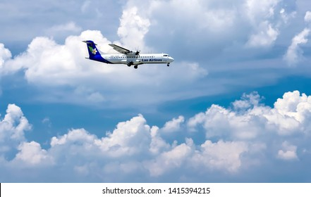 Ho Chi Minh City, Vietnam - June 1st, 2019: Lao Airlines airplane ATR72 flying through clouds sky prepare to landing at Tan Son Nhat International Airport, Ho Chi Minh City, Vietnam