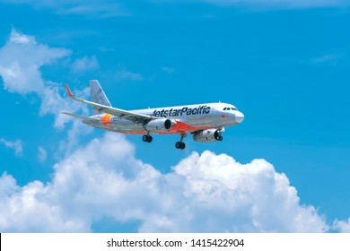Ho Chi Minh City, Vietnam - June 1st, 2019: Aircraft airbus A320 of Jetstar Pacific flying through clouds sky prepare to landing at Tan Son Nhat International Airport, Ho Chi Minh City, Vietnam