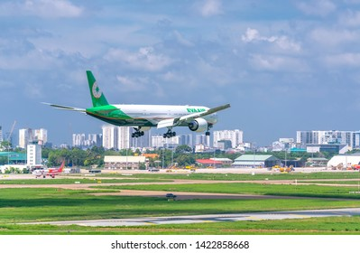 Ho Chi Minh City, Vietnam - June 8th, 2019: Airplane Boeing 777 of EVA Air flying over urban areas prepare to landing at Tan Son Nhat International Airport, Ho Chi Minh City, Vietnam