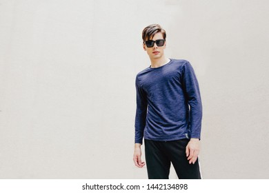 Ho Chi Minh city, Vietnam, June 30 2019: Portrait of a young handsome man, model of fashion, wearing T-shirt, jacket or shirt, hoodie, jeans or khaki, professional model outdoors