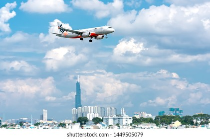 Ho Chi Minh City, Vietnam - June 18th, 2019: Passenger airplane Airbus A320 of Jetstar Pacific  flying over urban prepare to landing at Tan Son Nhat International Airport, Ho Chi Minh City, Vietnam