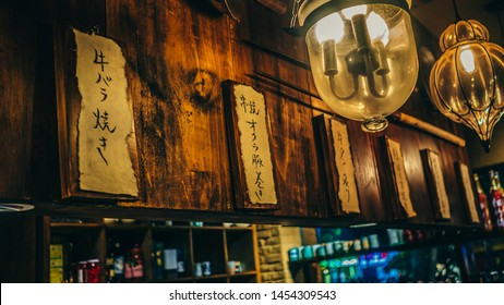 Ho Chi Minh City / Vietnam - July 14th 2019: Lamps and signs inside an Izakaya restaurant, izakaya is a type of informal Japanese pub popular for after-work drinking.
