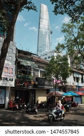 Ho Chi Minh City, Vietnam - 02/17/2019: View of the Bitexco tower from the street with a motorbike in front of it.