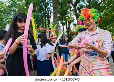 Ho Chi Minh city, Vietnam - Sep 2019: A freelance clown creating balloon in different shapes for kids