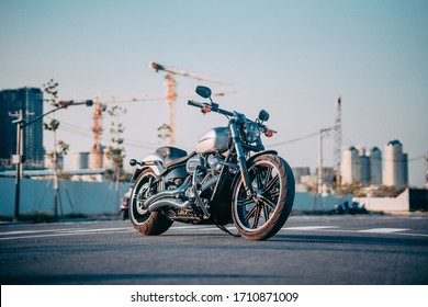 Ho Chi Minh city, Vietnam - March 25 2020: Harley Davidson Break Out 114 2020 is parked outdoor in Ho Chi Minh city. Milwaukee-Eight large V2 engine. Landmark 81 and Bitexco tower in blur background