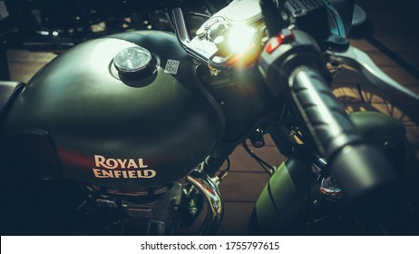 HO CHI MINH CITY / VIETNAM, JUNE 2020 - Royal Enfield motorbike is displayed showcase in a coffee shop in District 1, Ho Chi Minh city, Vietnam
