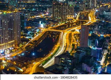 Ho Chi Minh City, Vietnam - July 19th, 2020: Night cityscape from above with lightstreet riverside create shimmering nocturnal beauty city developing dynamically in Ho Chi Minh City, Vietnam