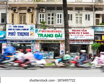 Ho Chi Minh City, Vietnam - July 25, 2020: Motorbikes passing at speed down D. Tran Hung Dao, one of the boulevards of District 1 in Ho Chi Minh City.