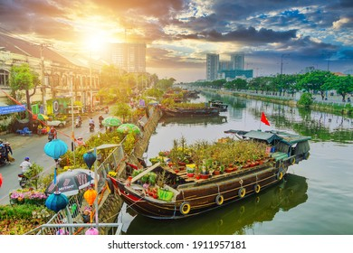 Ho Chi Minh city, Vietnam - 7 Feb 2021: Springtime in Saigon, boat on canal, transport spring flower for Tet to Ben Binh Dong open air market, Vietnamese happy with Lunar New Year, Vietnam