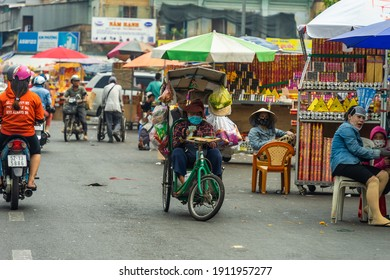 Ho Chi Minh city, Vietnam - 7 Feb 2021: View of people in Cholon Chinatown Market before Tet. Biggest place selling decorate for Vietnamese Lunar New Year in Cholon (Binh Tay Market), District 05